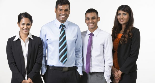 Team of four  happy Indian business people. isolated on a white background.