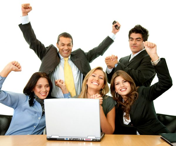 Business team in an office excited from their success